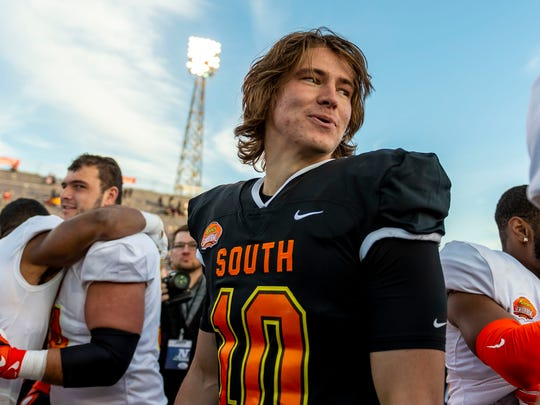 Jan 25, 2020; Mobile, AL, USA; South quarterback Justin Herbert of Oregon (10) talks with players after the 2020 Senior Bowl college football game at Ladd-Peebles Stadium. Mandatory Credit: Vasha Hunt-USA TODAY Sports