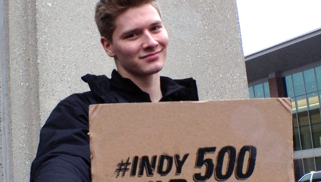 Indycar driver Josef Newgarden  jokes with the fans before the autograph session.