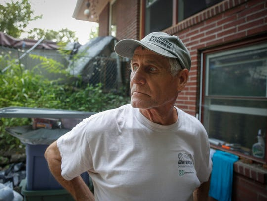 Kirby Heidt looks back across his patio as he recalls