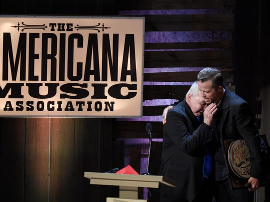 John Prine and Jason Isbell hug after Prine presented Isbell with Album of the Year at the 2016 Americana Music Honors and Awards Show at Ryman Auditorium Wednesday, Sept. 21, 2016, in Nashville, Tenn.