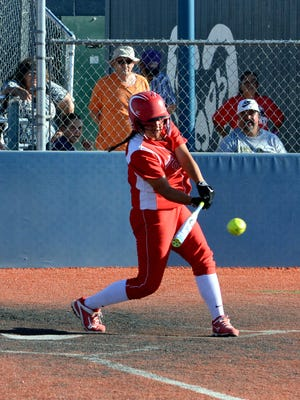 Loving's Andrica Gomez hits a single up the middle Thursday against Capitan.