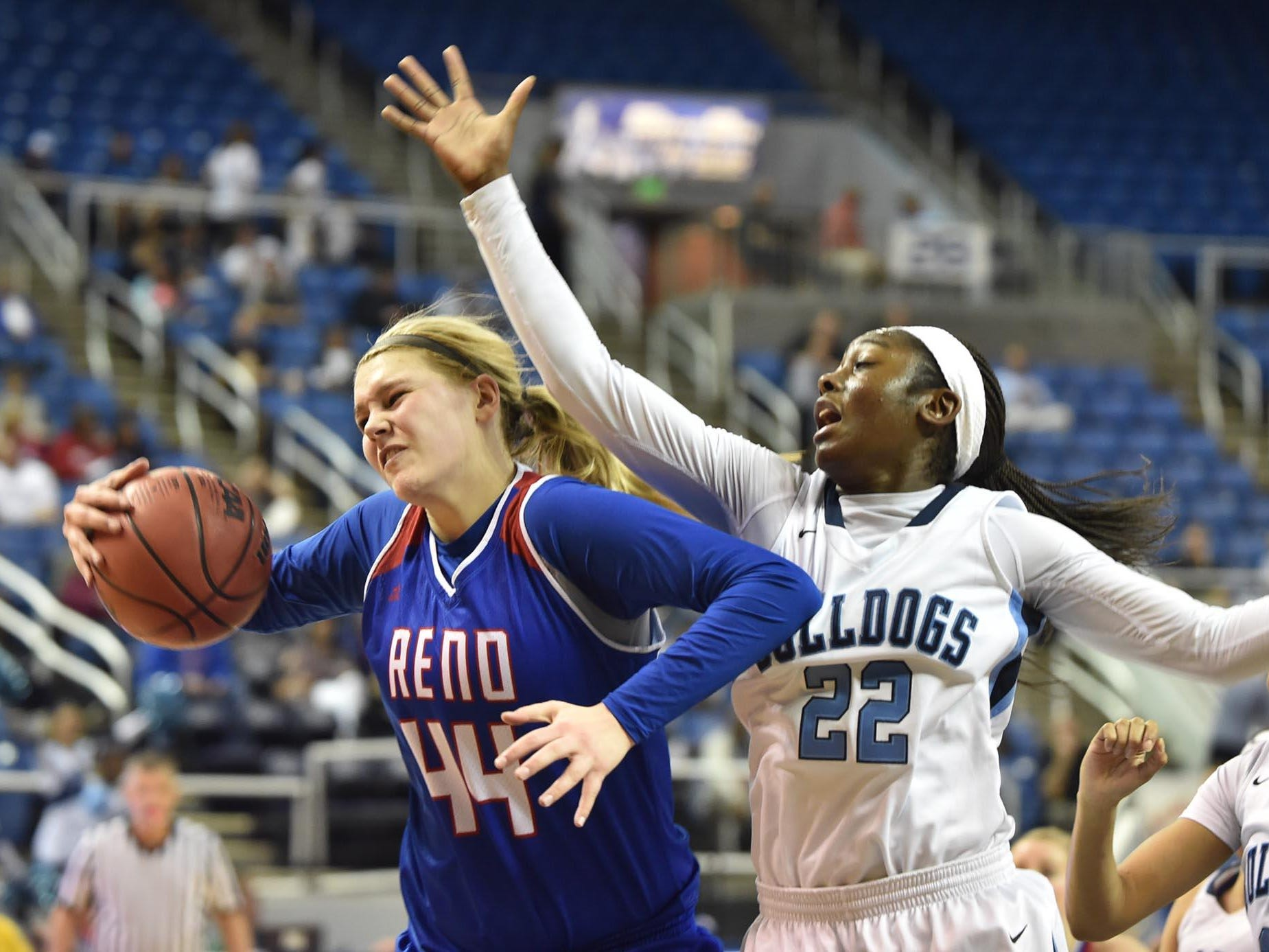 Reno's Mallory McGwire grabs a rebound against Centennial during the Division I state tournament in Reno.