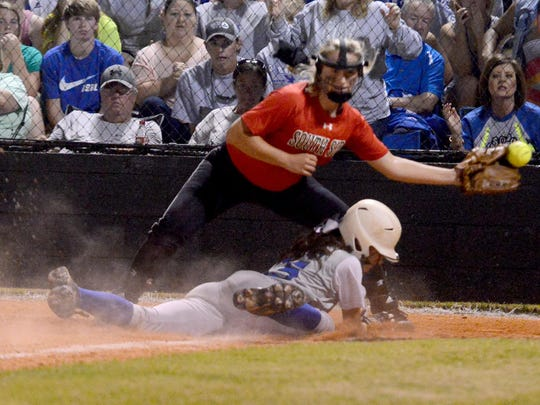 Chester County's Paige Pipkin slides safely to home during Wednesday's game against South Side.