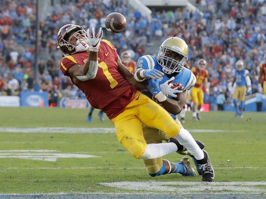 Southern California wide receiver Velus Jones Jr. (1) fails to make a one-handed catch at the goal line as UCLA defensive back Adarius Pickett (6) defends during the second half of an NCAA college football game Saturday, Nov. 17, 2018, in Pasadena, Calif. (AP Photo/Marcio Jose Sanchez)