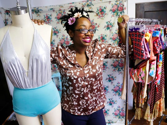 Fashion designer Danisha Brown with her colorful designs Tuesday, March 24, 2015, in her Lafayette studio. Brown grew up in Lafayette and moved back after studying at the Indianapolis Art Institute. She began working at an early age, and said her mother instilled in her a strong work ethic. Brown said she was also influenced by other women in her family who, like her mother, were determined to be successful.
