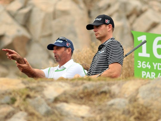 Idyllwild-native Brendan Steele and his caddie discuss his drive on the 364-yard par 4 sixteenth hole during the final round of the Humana Challenge on Sunday, January 25, 2015 at the Palmer Private Course at PGA West in La Quinta, Calif. Steele's round of 64 put him in a five-way tie for second at the end of the day.