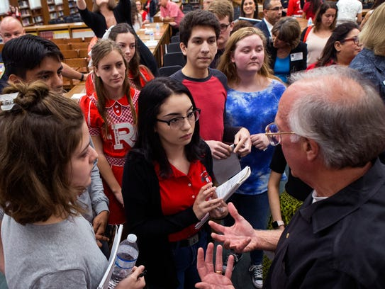 State Rep. Todd Hunter (right) talks with students,