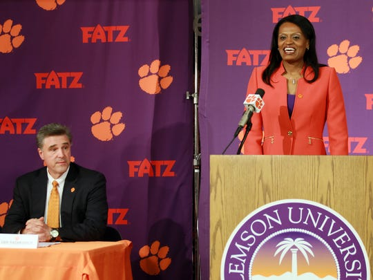 Clemson athletic director Dan Radakovich looks on as Audra Smith during her introductory press conference as Clemson women's basketball coach in 2013.