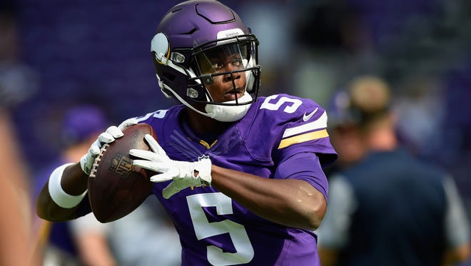 Teddy Bridgewater of the Vikings warms up before the game against the Chargers Sunday at US Bank Stadium in Minneapolis.
