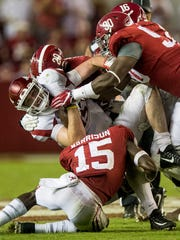Arkansas quarterback Cole Kelley (15) is tackled by Alabama linebacker Shaun Dion Hamilton (20), defensive back Ronnie Harrison (15), linebacker Jamey Mosley (16) and defensive lineman Jamar King (90) in second half action at Bryant Denny Stadium in Tuscaloosa, Ala. on Saturday October 14, 2017. (Mickey Welsh / Montgomery Advertiser)