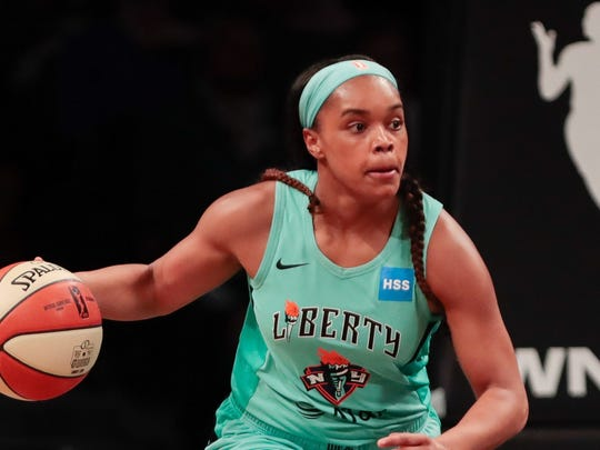 New York Liberty guard Asia Durr (25) dribbles up court during the preseason WNBA game against the China National Team at Barclays Center on May 9, 2019.