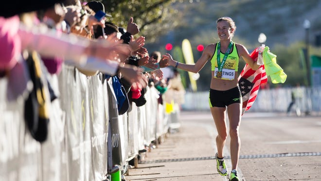 Amy Hastings of Flagstaff celebrates after winning the P.F. Chang's Rock 'n' Roll Arizona Half Marathon in Tempe on Jan. 18, 2015.