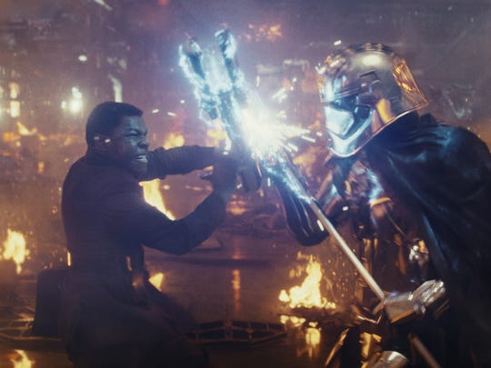 Finn (John Boyega, left) has another run-in with Captain Phasma (Gwendoline Christie) in 'Star Wars: The Last Jedi.'