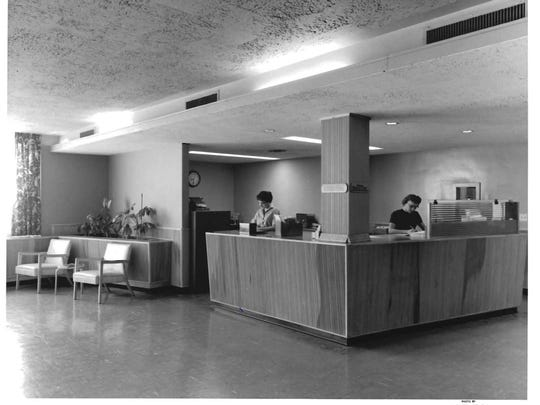Great Falls Clinic reception staff work at the front desk at 1220 Central Ave. in 1959. The building was later home to the Clinic's Immediate Care Center.