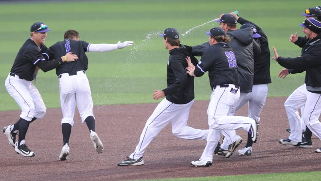 ACU players mob Dalon Farkas, near left, after his game-winning double in the bottom of the 10th inning. The Wildcats beat Creighton 8-7 on Saturday, March 4, 2017 at Crutcher Scott Field for their sixth consecutive victory.