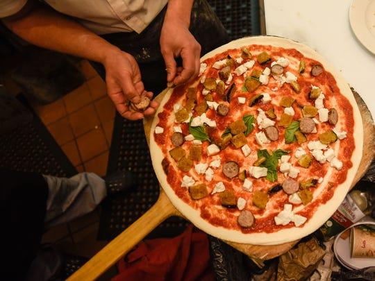 Sausage Siciliana pizza with buffalo mozzarella and