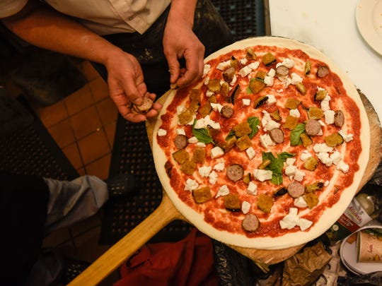 Sausage Siciliana pizza with buffalo mozzarella and