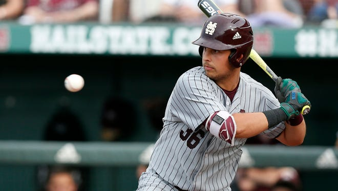Mississippi State's Nathaniel Lowe (36) watches a high pitch during their NCAA Regional Baseball Tournament game against Cal State Fullerton at Dudy Noble Field on Saturday.