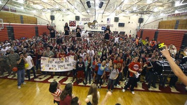 The student body of Bullitt East High School gathers for the final shot of the video in the gym.