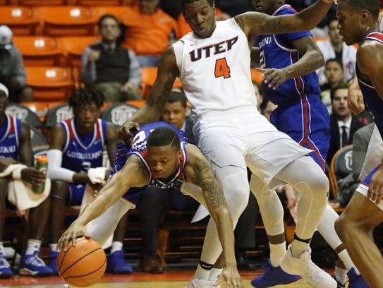 UTEP freshman forward Tyrus Smith, right, tries to