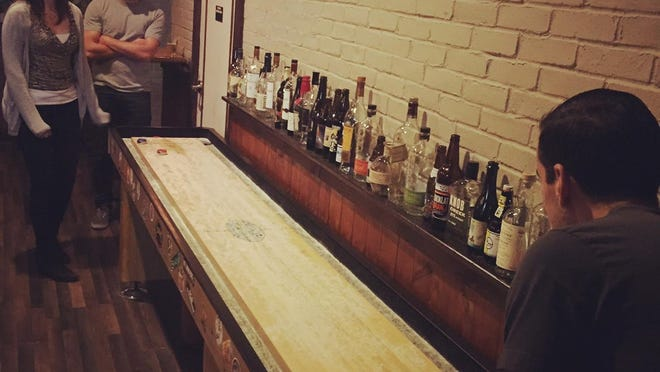 Sign up for the shuffleboard league at the Asbury Ale House.