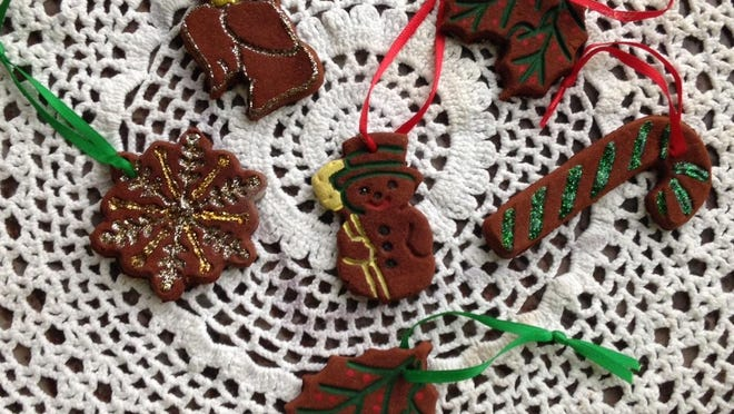 Cinnamon ornaments are created using cinnamon, applesauce and glue.
