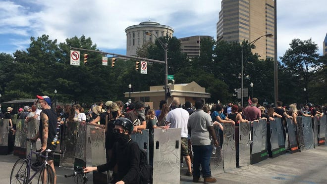 About 150 protesters took over the middle of the Broad and High Streets intersection for about 30 minutes Sunday afternoon.
