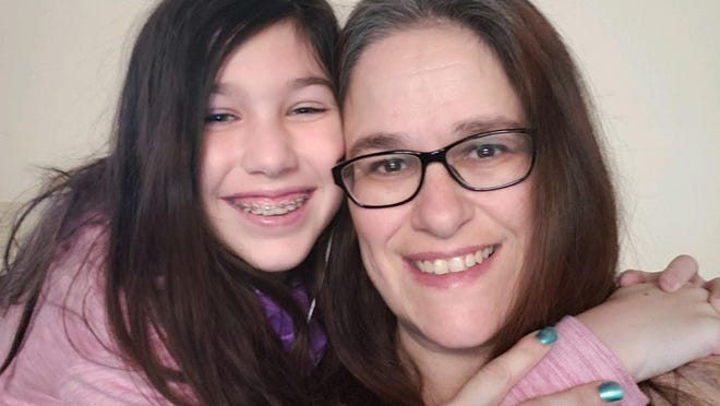 Teddie and her daughter Nikki pose for a photo at their home. Nikki recently celebrated her 13th birthday by raising funds for Seacoast Family Promise, a nonprofit organization that helped her family get out of homelessness 13 years ago.