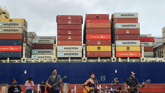 Lyn Avenue performs on the Savannah River at the new Plant Riverside District.