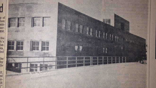 "Rear view of the new Courthouse in 1955 shows the ""penthouse"" where air conditioning units could be added later."