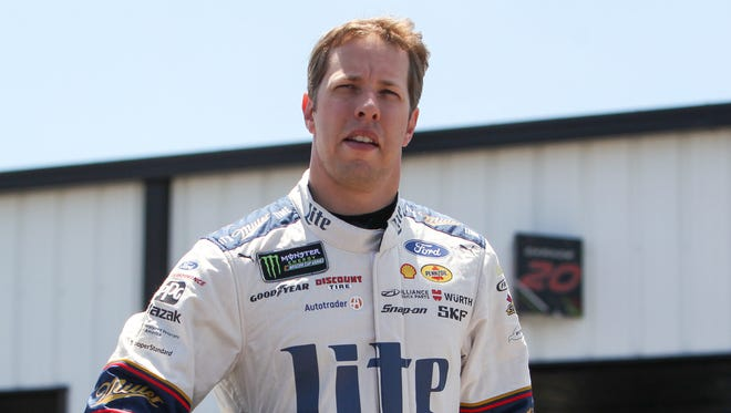 Brad Keselowski (shown) and teammate Joey Logano swept the top two spots for Team Penske in NASCAR Cup Series qualifying at Michigan.