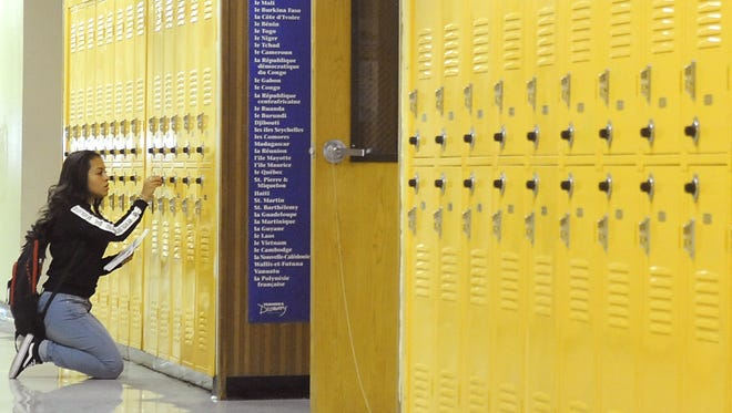 A student opens her locker at Fernley High School on the first day of the 2016/17 school year.