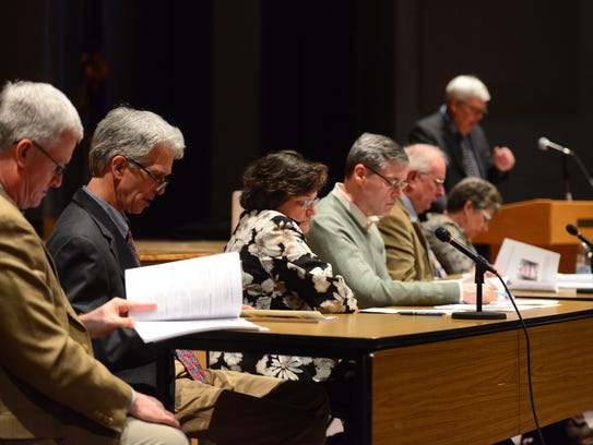 Williston officials thumb through the annual town report