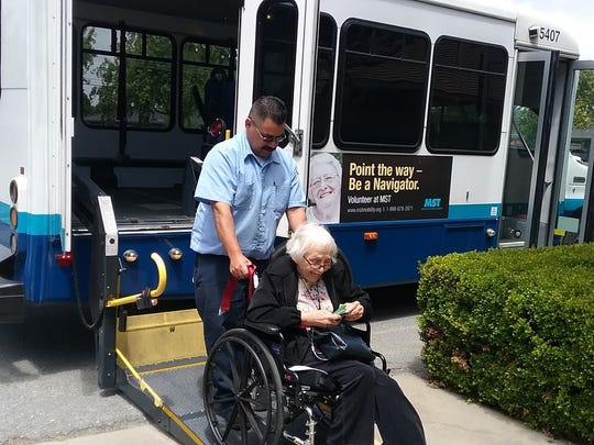 Marjorie Atkinson, 95, leaves Madonna Manor in Salinas to meet friends for lunch in Carmel Valley. MST RIDES program provides the bus transit.  Here driver Joe Perez helps load Atkinson's wheelchair onto the bus.
