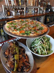 Clockwise from top: Giuseppe Pizza, Apple Salad and Tommy's Original Coal Oven Roasted Wings.