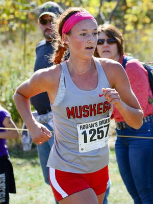 Muskego junior Kate Jochims nears the finish line in second place at the Racine Case Invite.