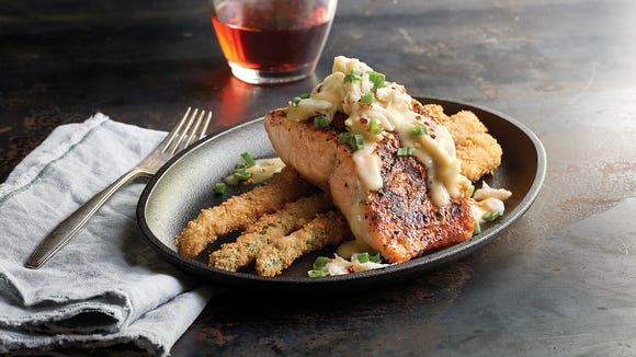 The salmon Oscar at Saltgrass Steak House is a truly indulgent meal you don't have to feel too guilty about.