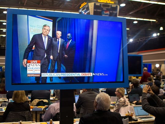 Republican candidates miss their cues to enter the Presidential Debate at Saint Anselm College in Manchester, N.H. on Saturday, Feb. 6, 2016.