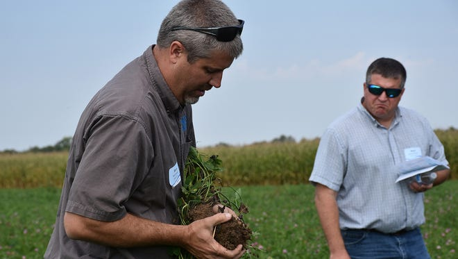 Barry Bubholz, area GLRI coordinator, shows a healthy soil sample during the Save the Bay Field Day on Sept. 15.