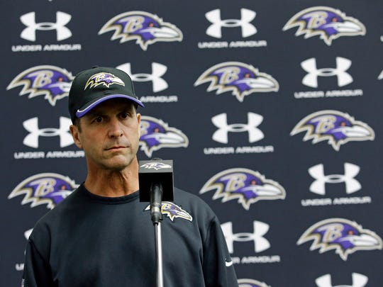 Baltimore Ravens head coach John Harbaugh speaks at a news conference after an NFL football practice at the team's headquarters, Monday, Sept. 8, 2014, in Owings Mills, Md. Ravens running back Ray Rice was let go by the Ravens on Monday and suspended indefinitely by the NFL after a video was released showing the running back striking his then-fiancee in February. (AP Photo/Patrick Semansky)