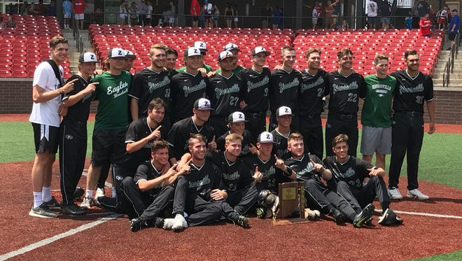 Zionsville's baseball team poses with the sectional trophy after defeating Kokomo on Monday.