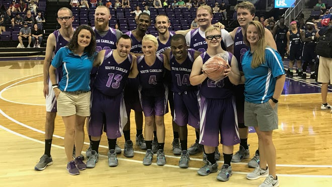 The Greenville team representing South Carolina won the silver medal in Unifield basketball at the Special Olympics USA Games in Seattle July 5. Zach Ward (with ball) received the game ball, and Lucas Ward (behind Zach), shared in his brother's success.