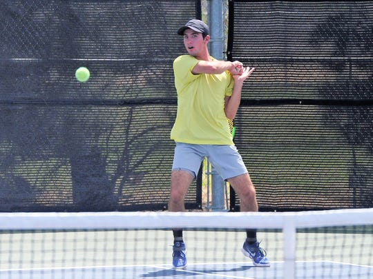 Wylie's Lane Adkins follows through on a shot during the Region I-4A tournament in Lubbock on Wednesday, April 18, 2018. Adkins reached the boys singles semifinals on Wednesday night.