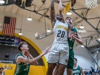 Battle Creek Central's Julius Johnson (20) goes for the hoop during the Chuck Turner Classic on Saturday.