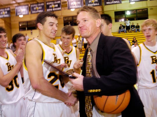 Senior forward Tyler Adams, left, congratulates Bishop Verot head coach Matt Herting after his 200th win in 2006. Adams played basketball all four years at Bishop Verot, earning honorable mention all-area in his senior year.