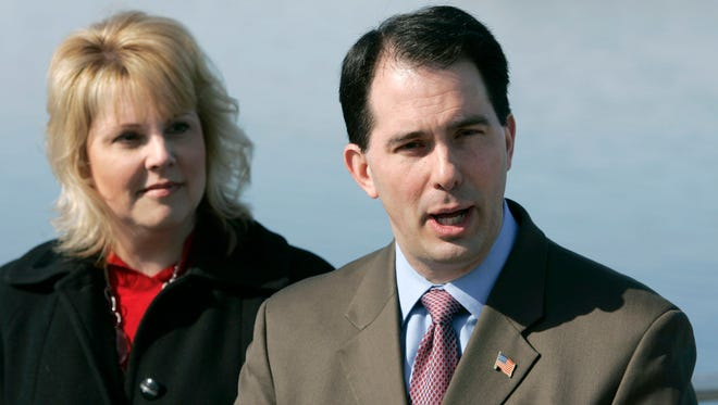 DNR Secretary Cathy Stepp, left, and Wisconsin Gov. Scott Walker .