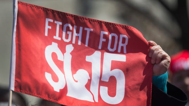 Demonstrators demanding an increase in the minimum wage march in the streets on April 14, 2016 in Chicago.