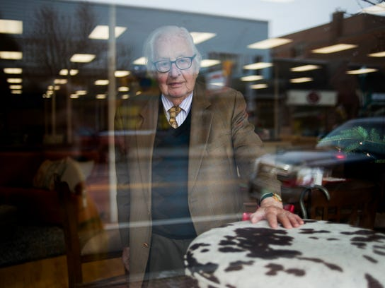 Tony Pomerleau, then 95, stands in 2012 in the window of Mill River Furniture in Newport at its grand opening. Pomerleau owned the building -- which happens to be where he got his first job at age 14 in 1931 -- trimming windows at JJ Newberry.