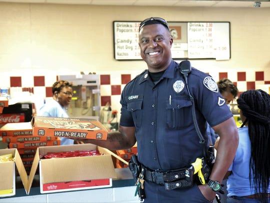 Jackson Police Officer Curtis Patrick Cozart stands
