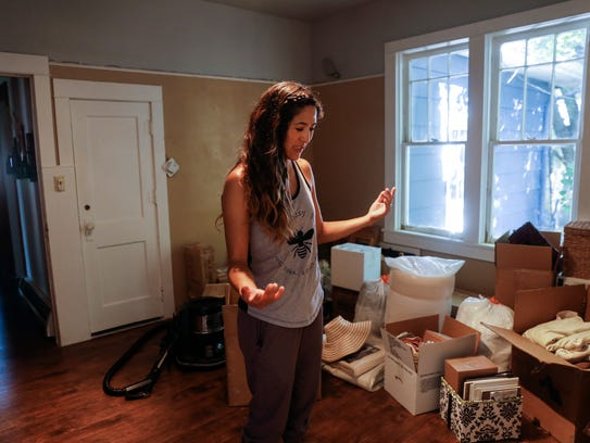 Melissa Silversmith Firestone looks over her possessions